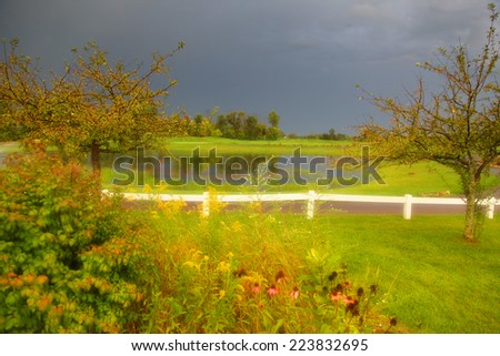 Dramatic landscape of Golf course with stormy sky  - stock photo