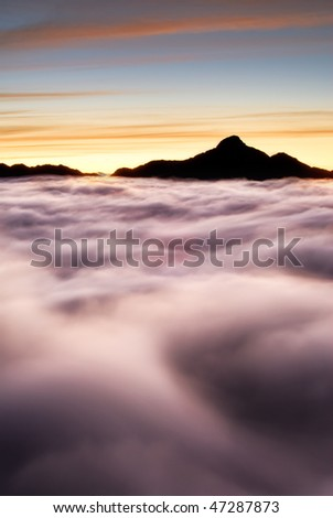 Dramatic landscape of mountain scenic with clouds in morning. - stock photo
