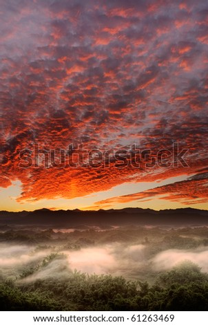 Dramatic landscape of sunrise scenery with red clouds in sky in countryside in Taiwan, Asia.