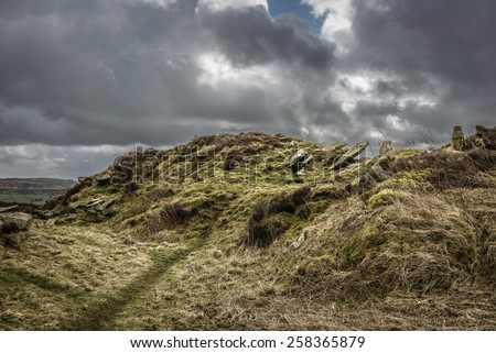 Dramatic landscape of the moors in Yorkshire, England with gloomy, stormy skies. - stock photo