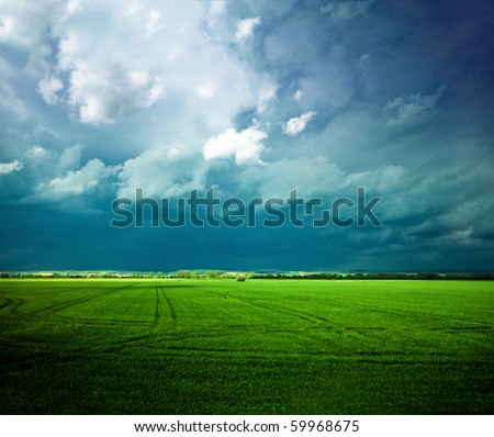 Dramatic landscape scenery of the spring field - stock photo
