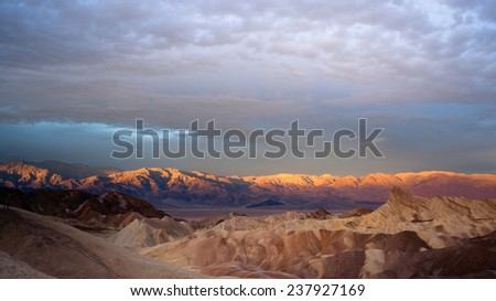Dramatic Light Badlands Amargosa Mountain Range Death Valley Zabriske Point - stock photo