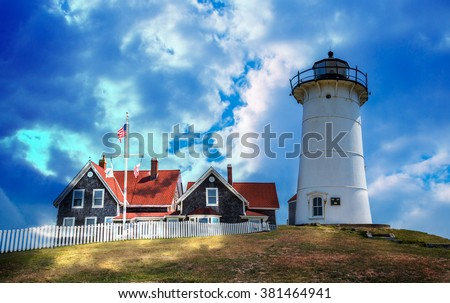 Dramatic light floods the Nobska lighthouse in Cape Cod - stock photo