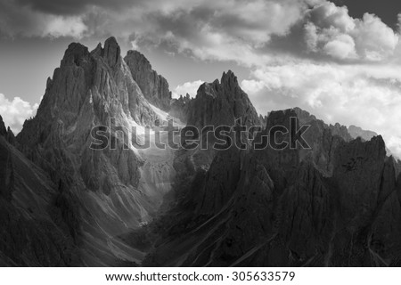 Dramatic light in Dolomites Mountains. Black and white landscape - stock photo