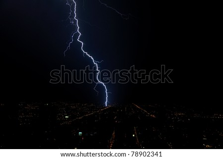 Dramatic lightning during a thunderstorm at night in the Midwest - stock photo