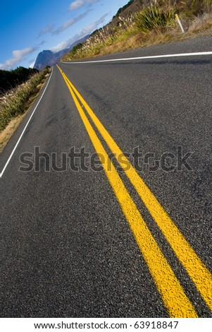 Dramatic long straight road to mt doom mountain, diagonal composition, new zealand - stock photo