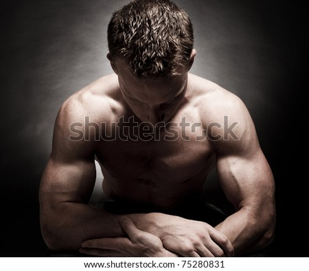 Dramatic male bodybuilder pose - stock photo