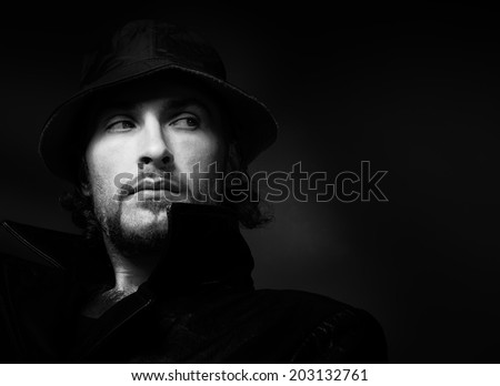 Dramatic male portrait. Black and white photo - stock photo