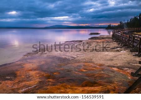 Dramatic Morning Sky at Yellowstone Lake near Lakeshore Geyser - stock photo