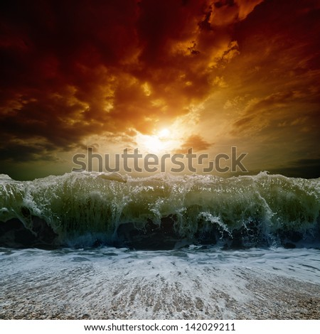 Dramatic nature background - big wave, stormy sea, red sunset