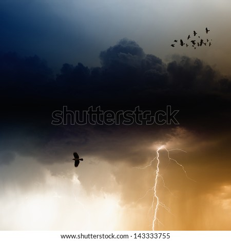 Dramatic nature background, bright lightning, flock of flying ravens, crows in dark sky - stock photo