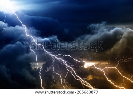 Dramatic nature background - bright lightnings in dark stormy sky  - stock photo