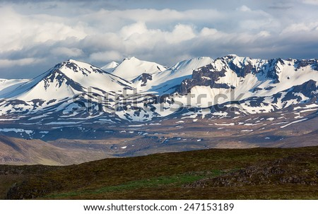 Dramatic nature with snowy mountains in Iceland. - stock photo