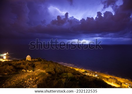 Dramatic night storm with lightning over the Mediterranean - stock photo
