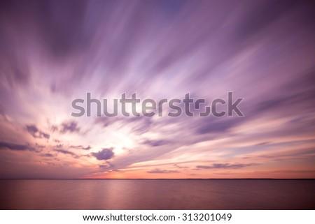 Dramatic ocean sunset - stock photo