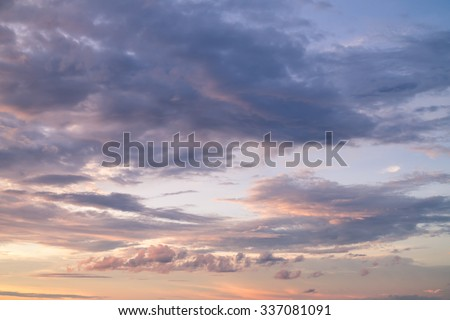 Dramatic orange grey purple sky and cloudy at sunset for background - stock photo
