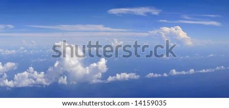 Dramatic panorama view of cloud formations on the borders of a storm depression over the Caribbean seas - stock photo