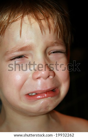 Dramatic photo of a kid crying - stock photo