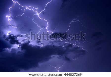 Dramatic photo of a Lightning bolt discharge in stormy night sky - stock photo