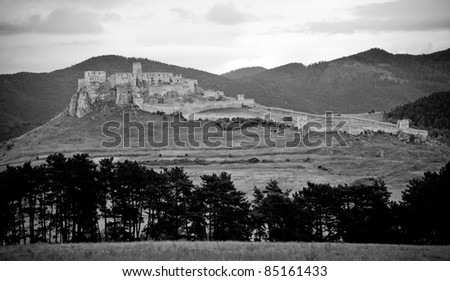 Dramatic picture of ancient Spis castle in black and white colors - stock photo
