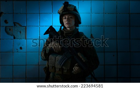 Dramatic portrait of a beautiful girl in uniform. Women in the military. U.S. Marines. Thoughts about the war. Young soldier.  - stock photo