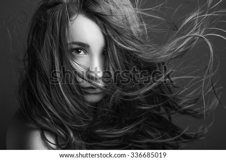 Dramatic portrait of a girl theme: portrait of a beautiful girl on a background, black and white photography