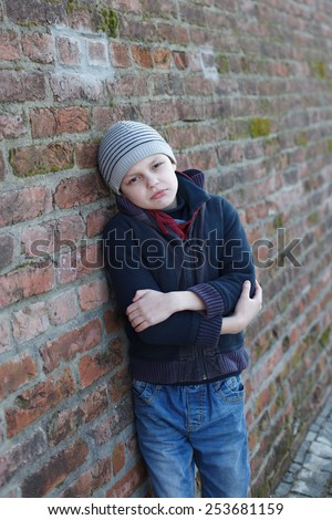 dramatic portrait of a homeless boy - stock photo