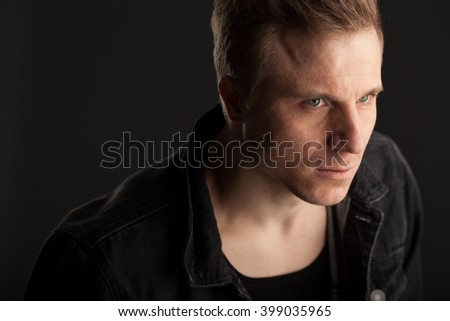 Dramatic portrait of a man , in a horizontal orientation