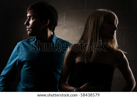 Dramatic portrait of a young elegant couple - stock photo