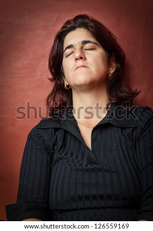 Dramatic  portrait of an hispanic woman suffering a strong depression - stock photo