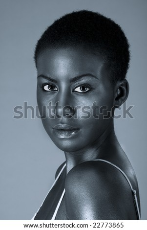 Dramatic portrait of young beautiful Afro American woman with short hair wearing make up (Black and white) - stock photo