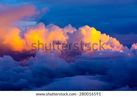 Dramatic rain cloud during sunset - stock photo