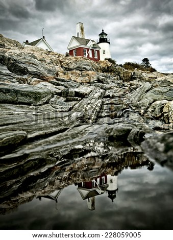 Dramatic reflection at Pemaquid Point Lighthouse in Maine, USA - stock photo