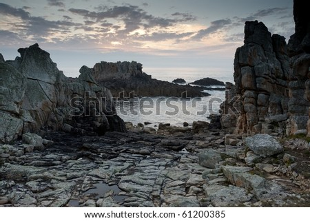 dramatic rocky coastline at dusk, ouessant island, brittany, france - stock photo