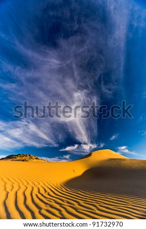 Dramatic sand dunes and sky in Namibia, Africa - stock photo