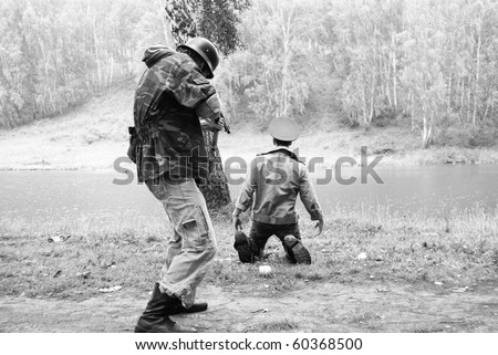 Dramatic scene of fight between soldiers black and white photo - stock photo