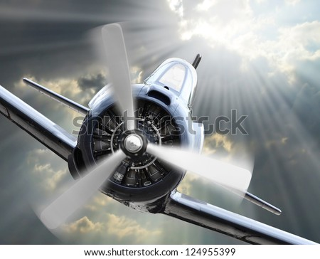 Dramatic scene on the sky. Vintage fighter plane inbound from sun. Retro technology background. - stock photo