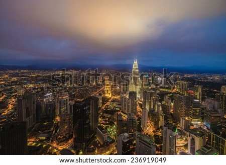 Dramatic scenery of the Kuala Lumpur city at blue hour - stock photo