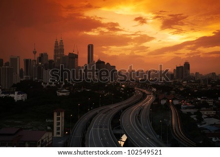 Dramatic scenery of the Kuala Lumpur city at sunset - stock photo