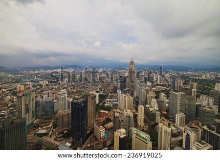 Dramatic scenery of the Kuala Lumpur city in the monsoon season in Malaysia - stock photo