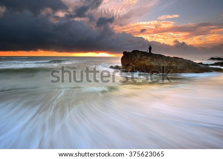 Dramatic seascape at sunrise  - stock photo
