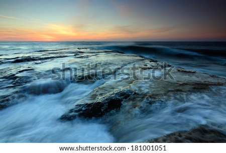 Dramatic seascape at sunset in Sabah, Borneo, Malaysia - stock photo
