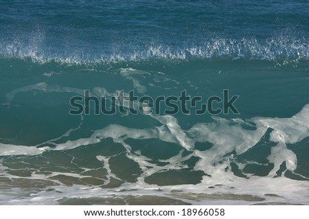 Dramatic Shorebreak Wave on a clear morning. - stock photo