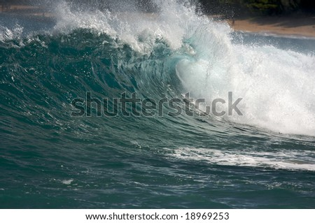Dramatic Shorebreak Wave on a clear morning.