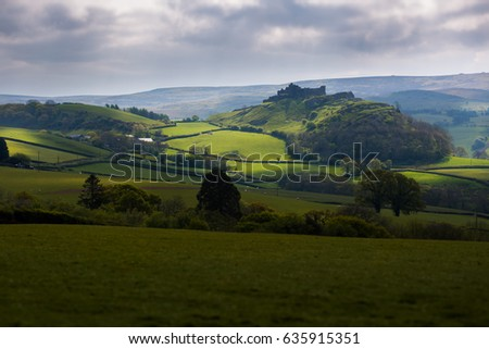 Dramatic Silhouette of Carreg Cennen Castle in the Beautiful Rolling Countryside of Carmarthenshire, Wales, UK
