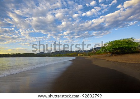 Dramatic skies and flowing water at sunset in Guanacaste - stock photo