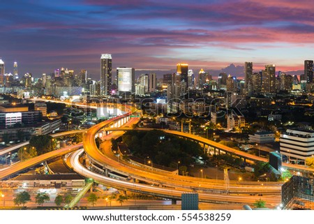 Dramatic sky after sunset over Bangkok city downtown and highway intersection, long exposure, Bangkok Thailand