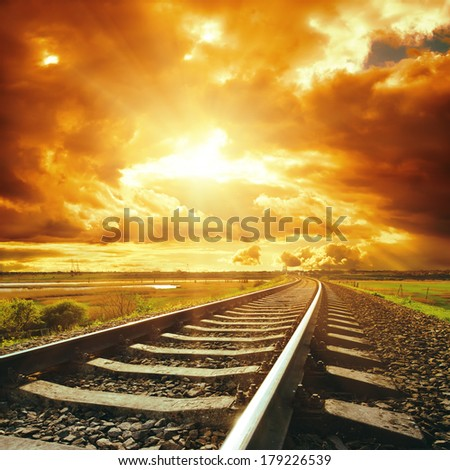dramatic sky and railroad - stock photo