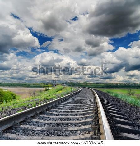 dramatic sky and railroad to horizon - stock photo