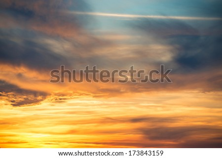 Dramatic sky at sunset with red, yellow, orange and blue colors - stock photo